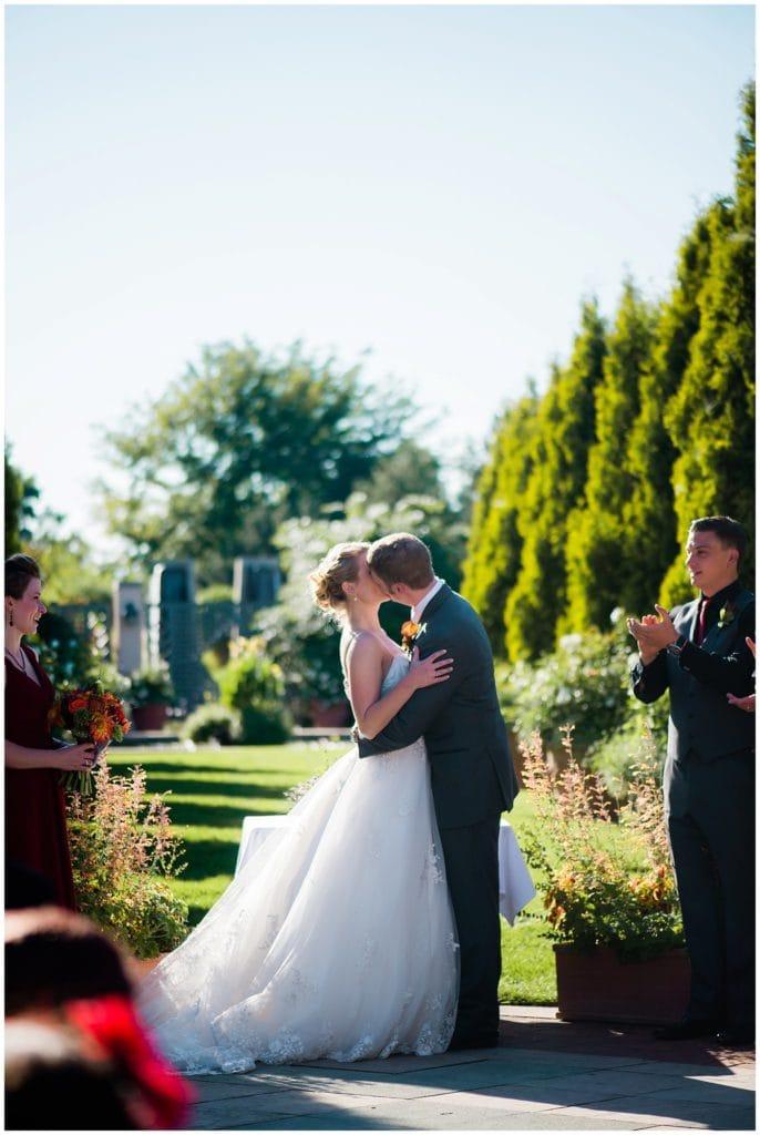 first kiss at Denver Botanic Gardens Romantic Garden ceremony photo