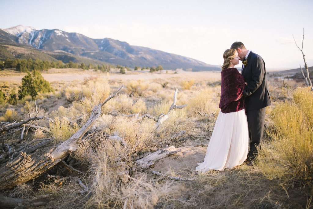 bride and groom eloping at Great Sand Dunes National Park by Vail Wedding Photographer Jennie Crate, Photographer