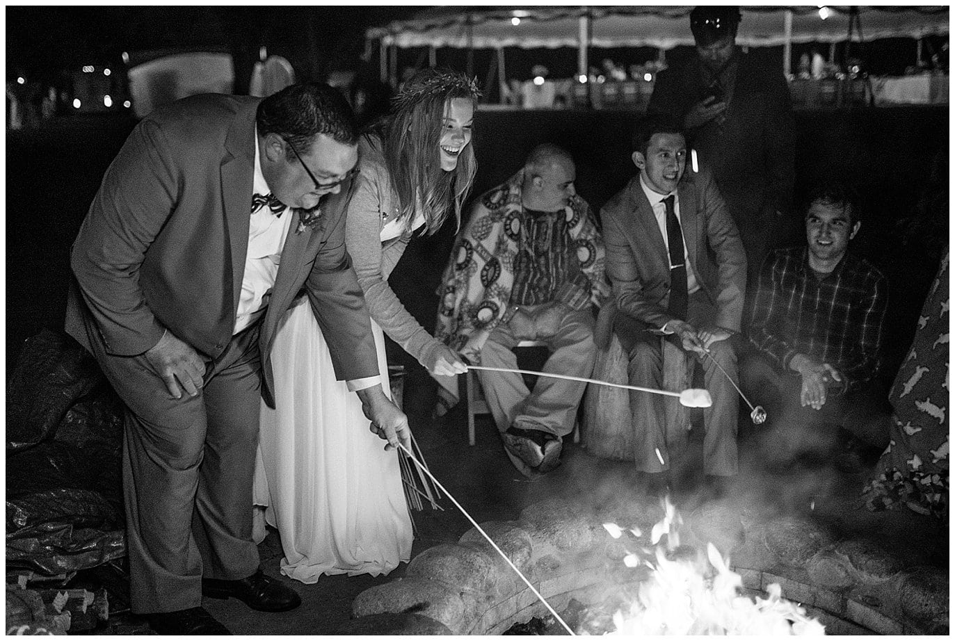 Couple by the fire at intimate colorado wedding