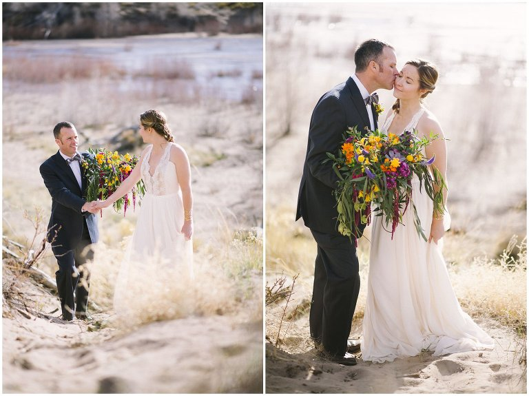 bride and groom explorking sand dunes wedding photo
