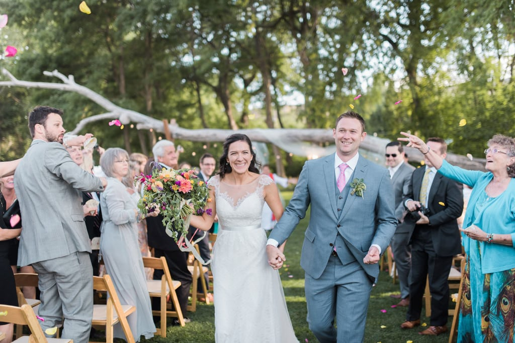 Bride and Groom exit ceremony to flower petal toss at Lyons Farmette by Denver Wedding Photographer Jennie Crate, photographer