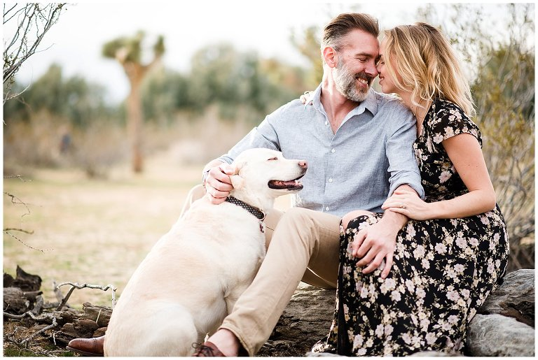 engagement session with couple and dog in desert photo