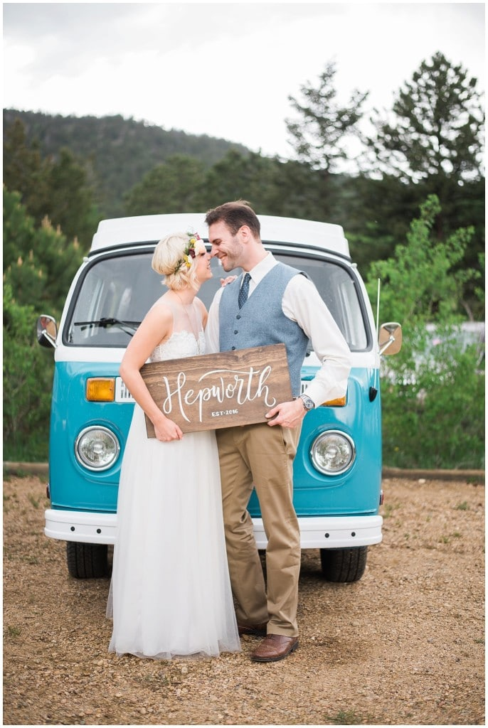 bride and groom in front of VW bus
