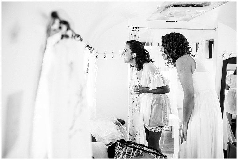 bride peeking at guests at Colorado farm wedding photo