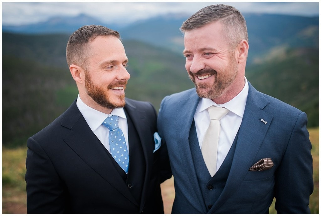 two grooms after ceremony at top of Vail Mountain Wedding Deck by Colorado Gay Wedding Photographer Jennie Crate Photographer