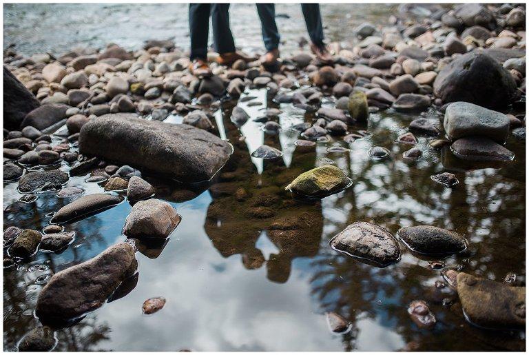reflection of grooms in colorado river wedding photo