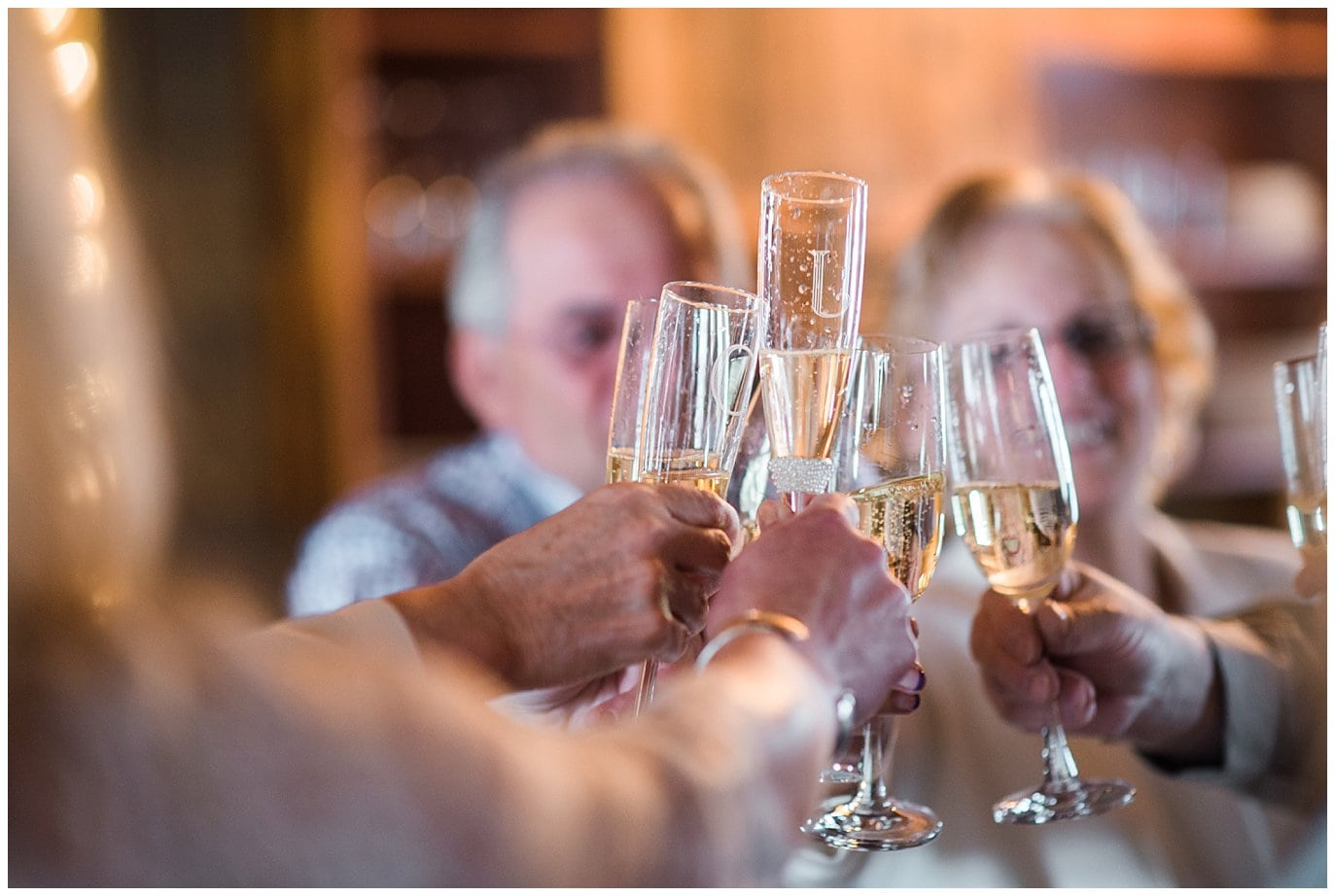 champagne toast at winter wedding photo