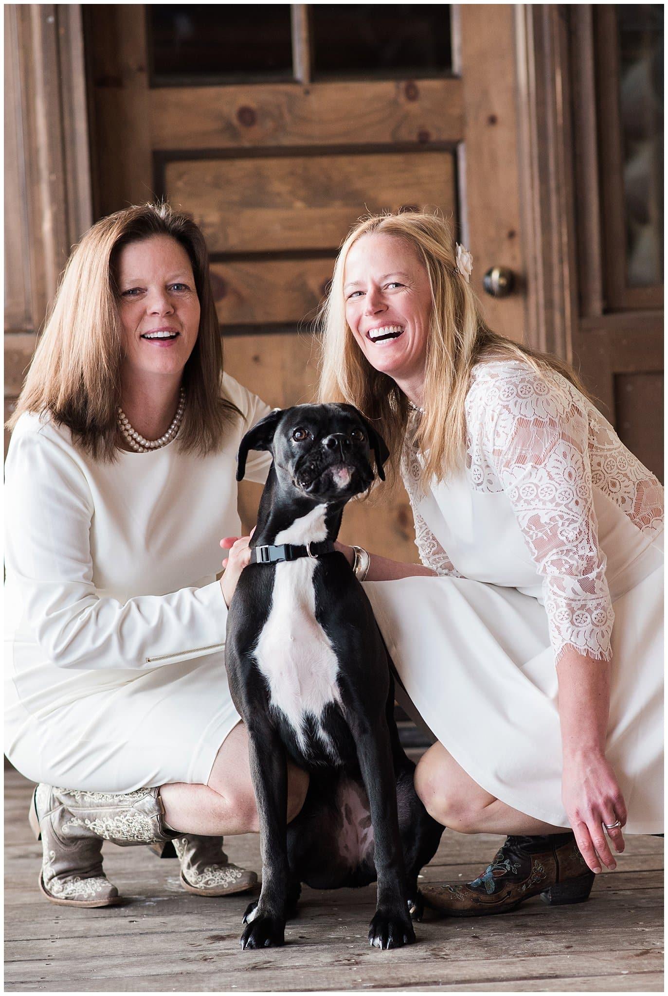 brides with dog on wedding day photo