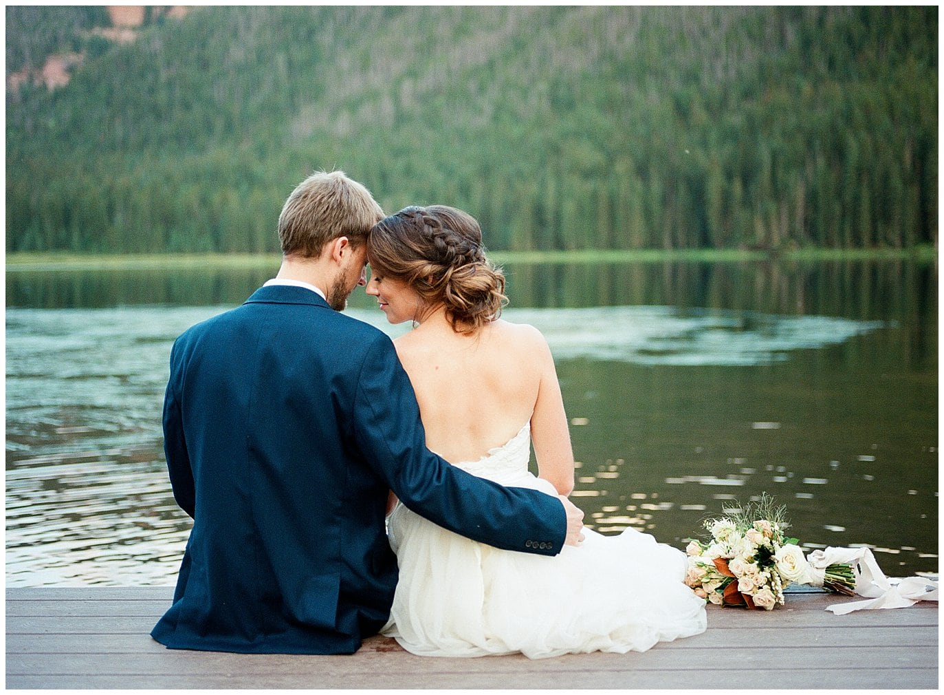 Couple by the lake at Piney River Ranch wedding by Estes Park Wedding Photographer Jennie Crate, Photographer