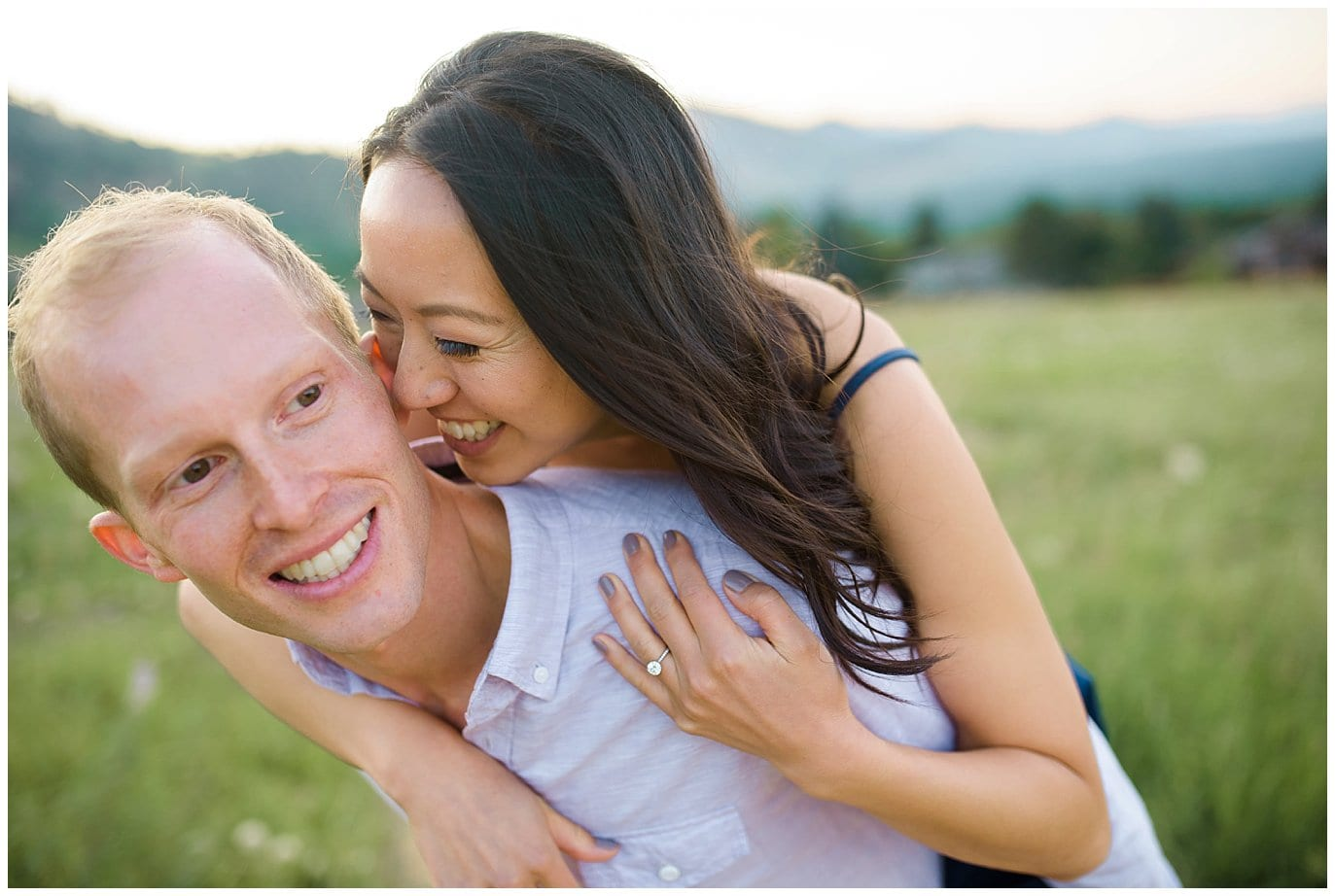laughing piggy back engagement photo