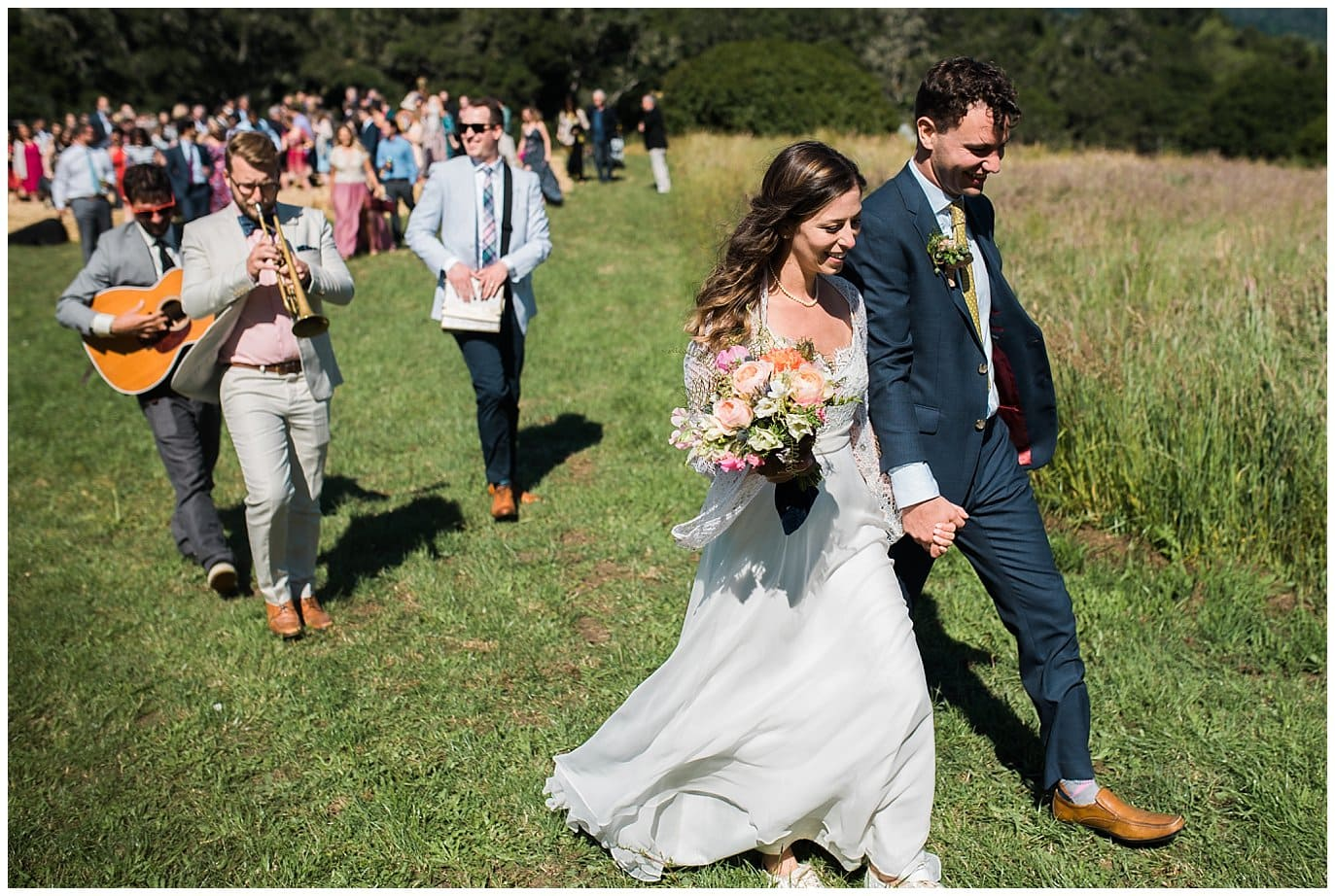 bride and groom serenaded by friends photo