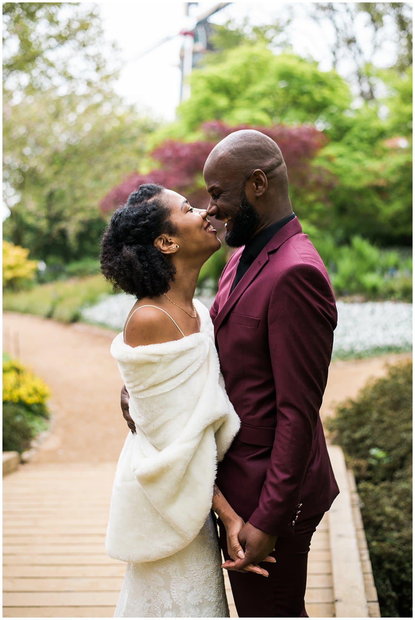 bride in white fur groom in maroon suit