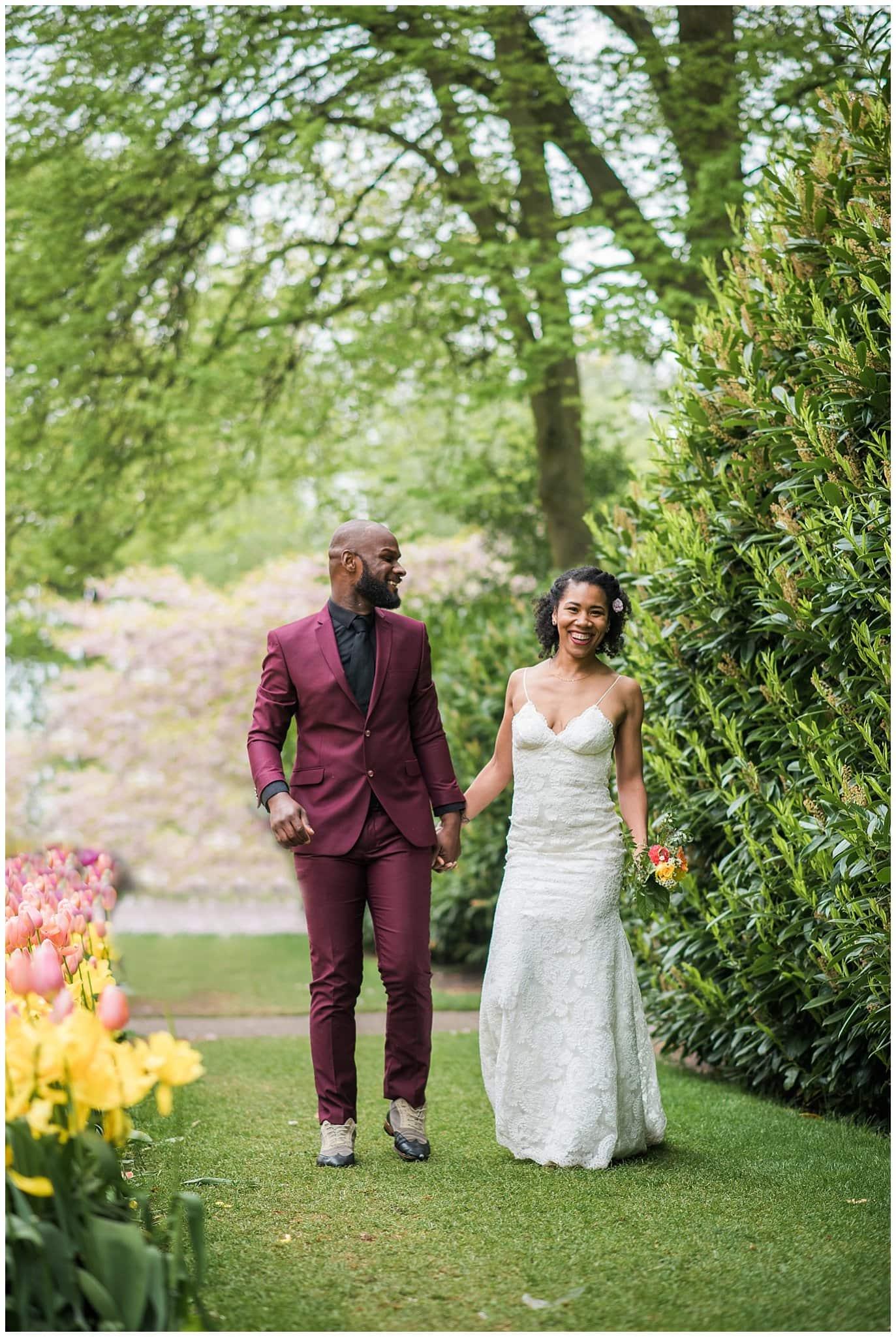 couple walking in tulip field in Natherlands