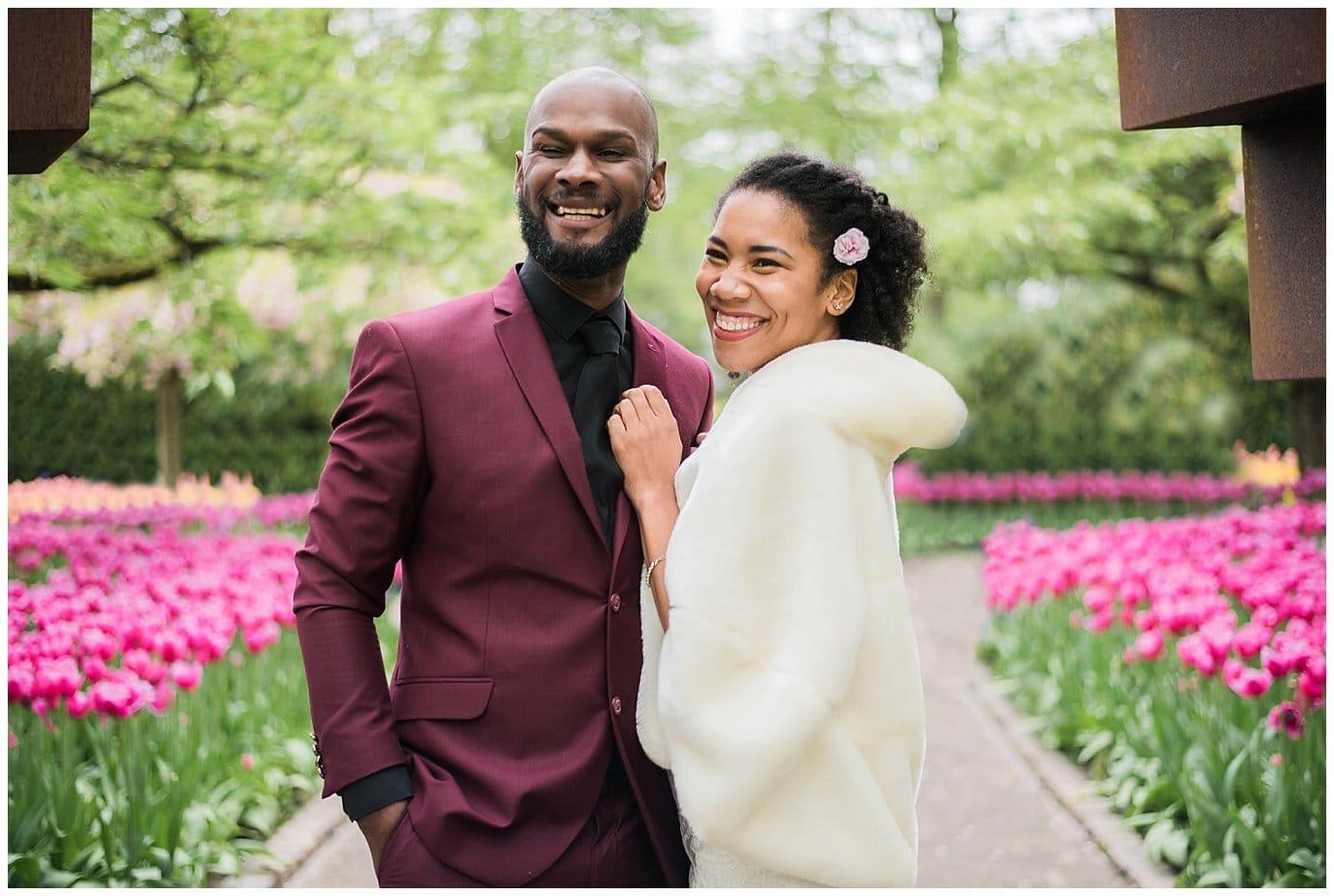 bride and groom in dutch tulip garden photo