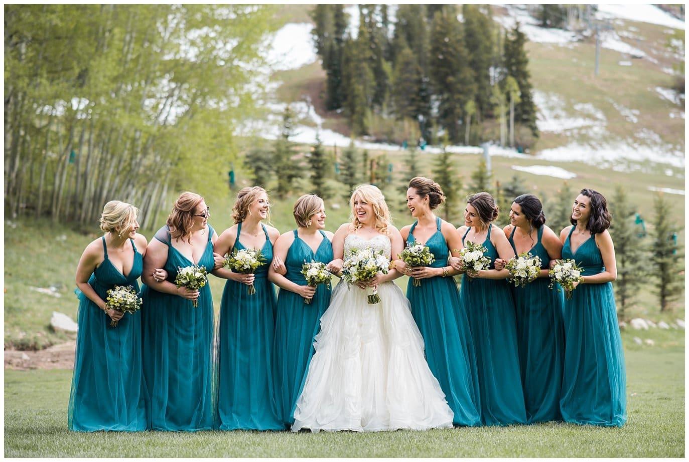 bridesmaids in teal bridesmaids dresses Beaver Creek wedding photo