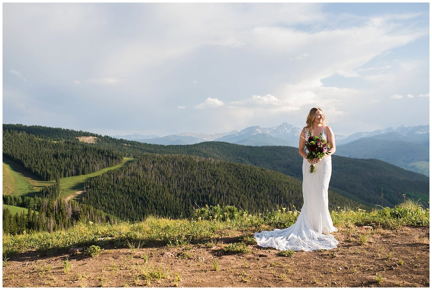 bride before ceremony in lace wedding dress at montaintop summer wedding in Vail Colorado
