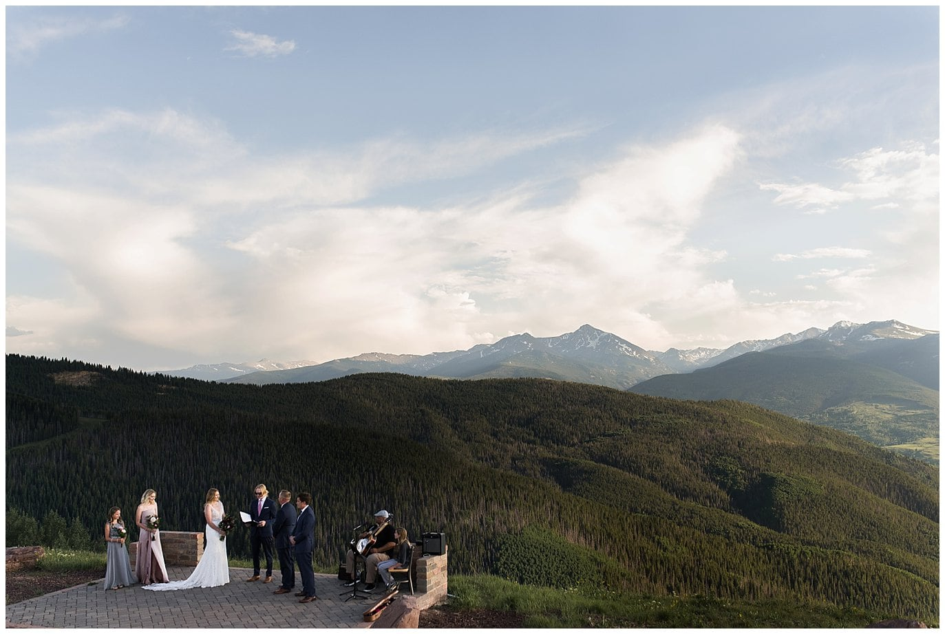intimate wedding ceremony at mountaintop summer wedding in Vail Colorado by Colorado wedding photographer Jennie Crate