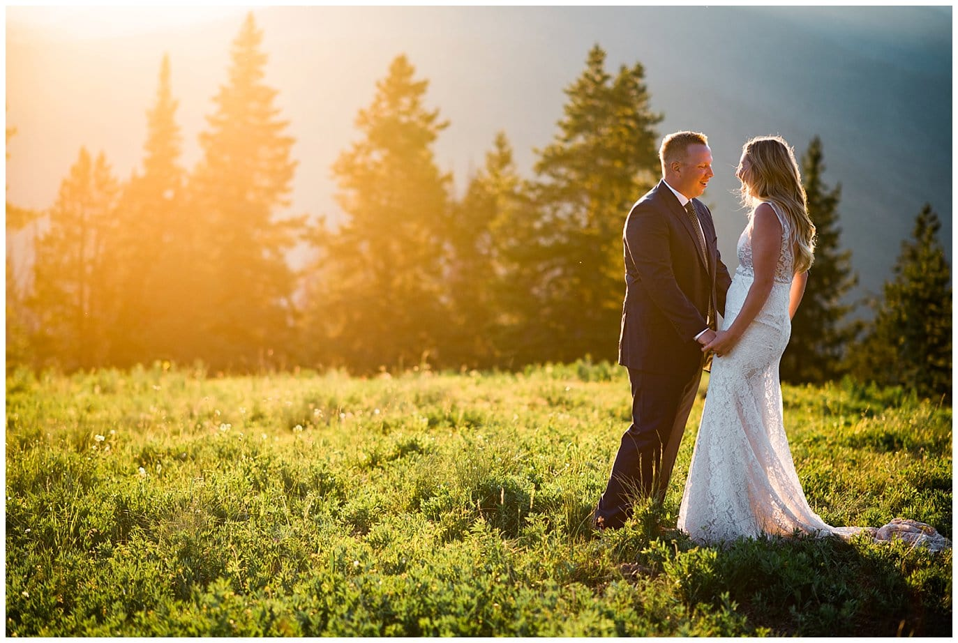 beautiful sunset photos of bride and groom after their mountaintop summer wedding by vail wedding photographer Jennie Crate
