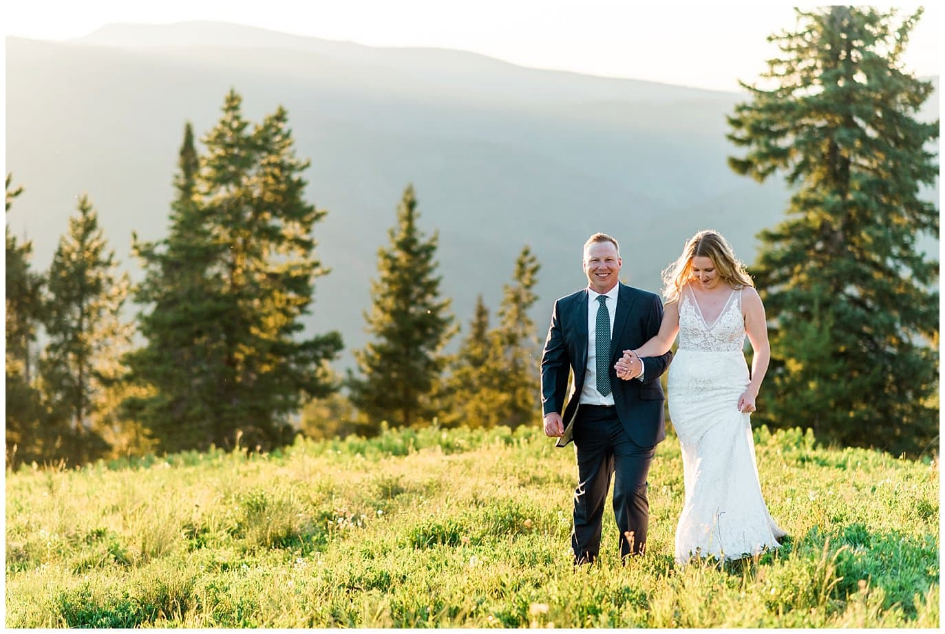 bride and groom at sunset on top of vail mountain photo