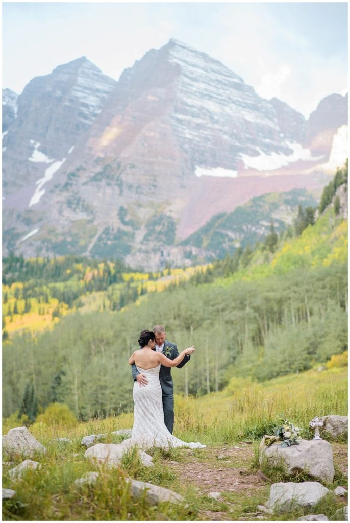 intimate first dance at Maroon Bells elopement by Colorado Elopement Photographer Jennie Crate Photographer