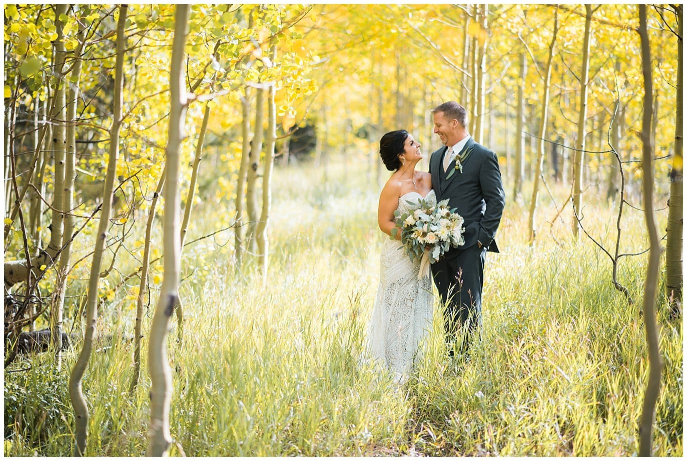 bride and groom in colorado aspens photo