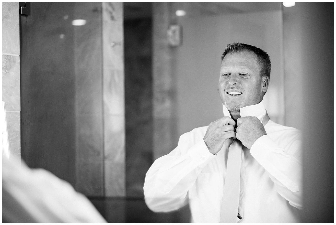 groom tying tie aspen colorado wedding