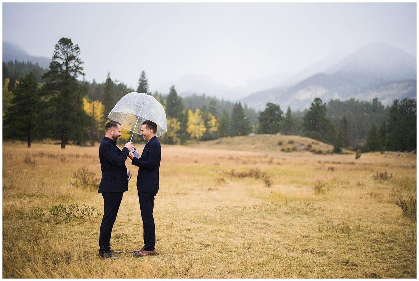 exchanging vows under umbrella photo