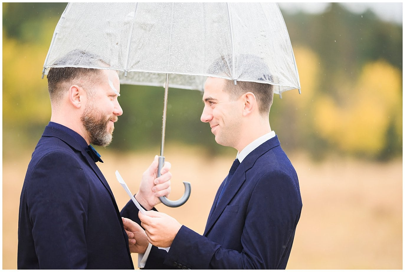 grooms saying vows in rainy elopement photo