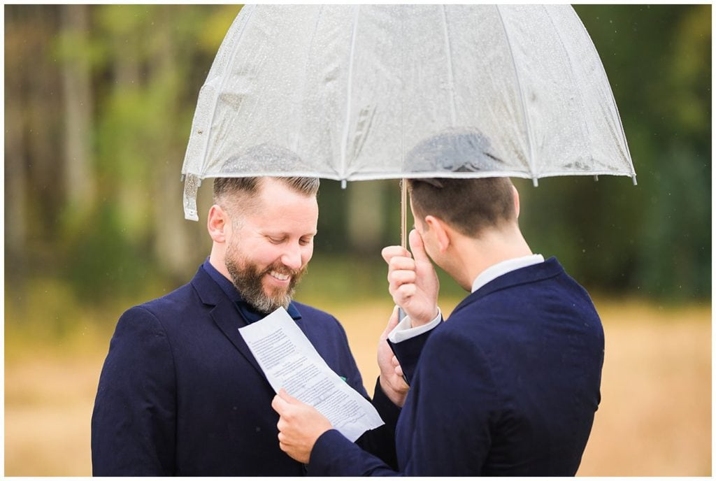 grooms saying vows in rain photo