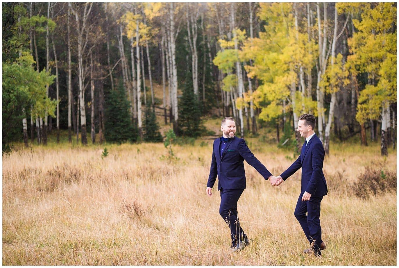 grooms walking in Colorado aspens photo