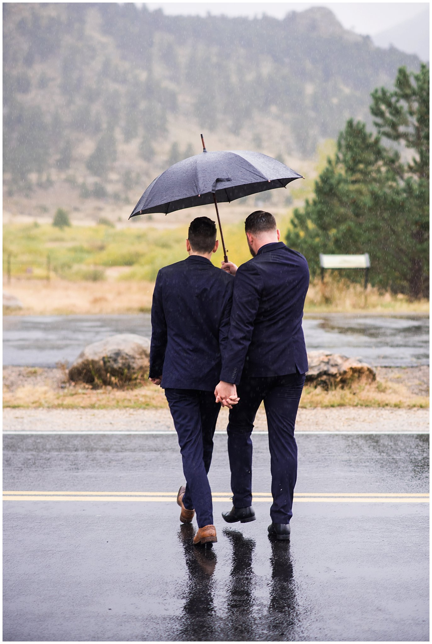 two grooms rainy day mountain elopement photo