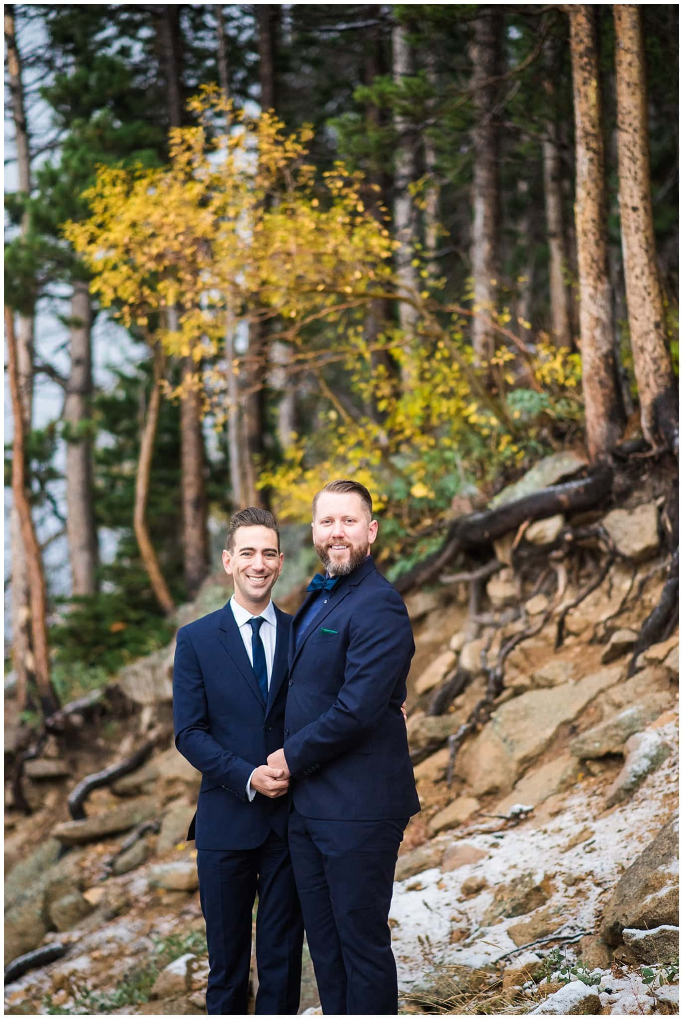 grooms in navy suits fall elopement photo