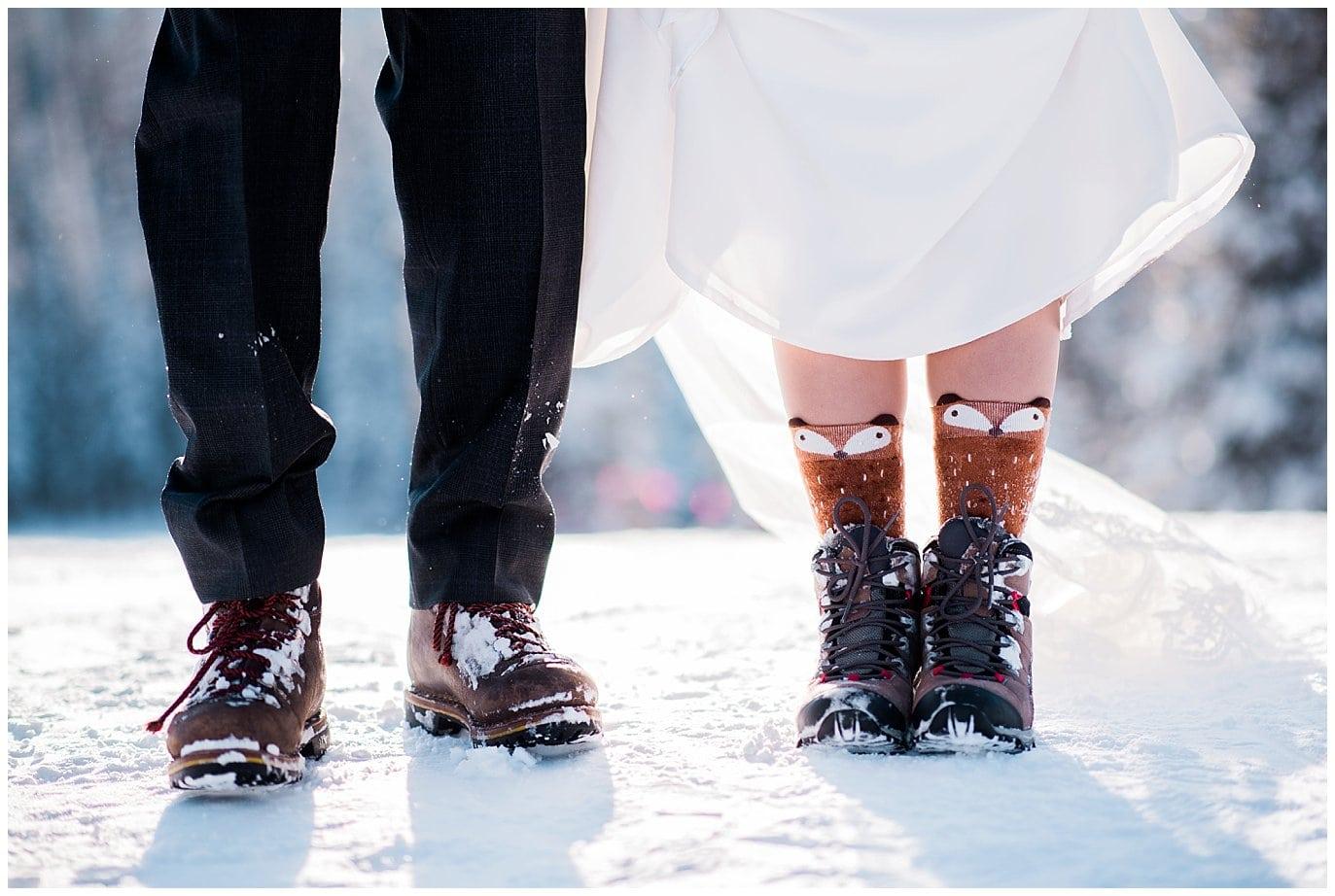 snow boots at winter wedding photo