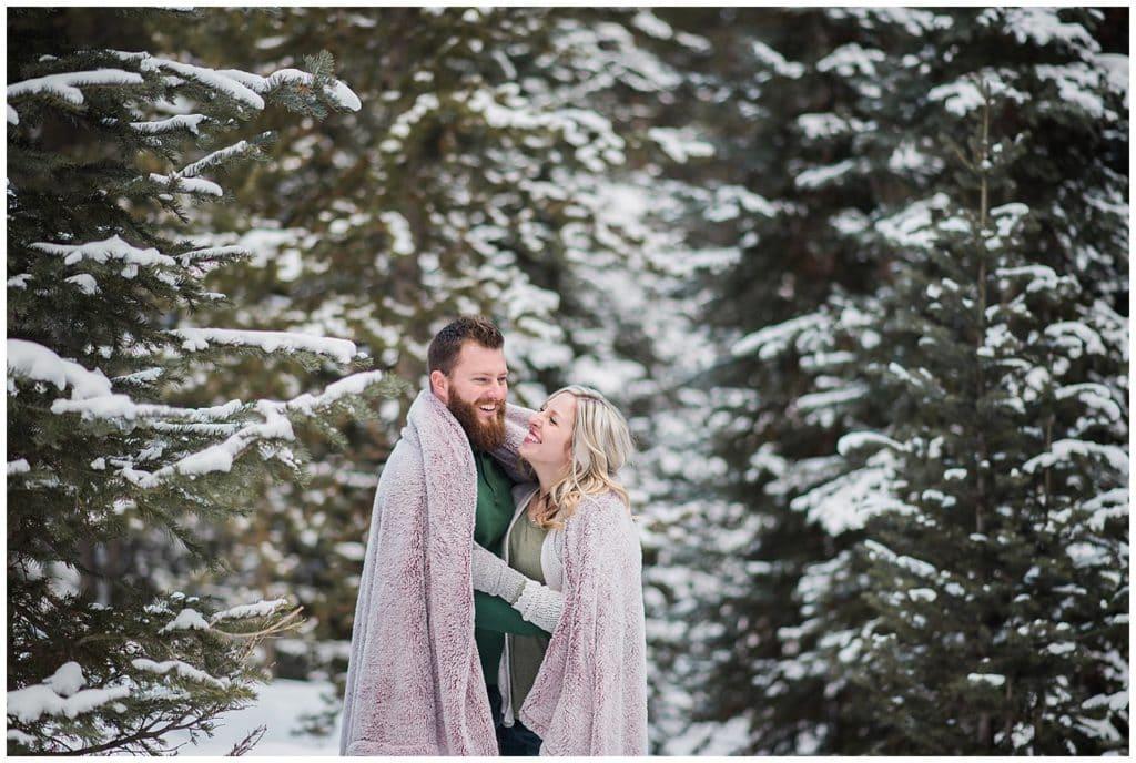 cozy winter engagement photo at boreas pass