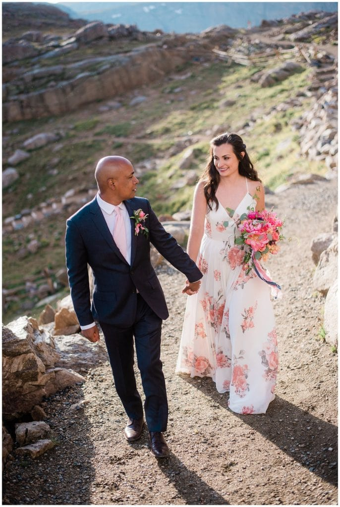 bride and groom walk hand and hand during Mt. Evans elopement by Colorado Elopement Photographer Jennie Crate Photographer