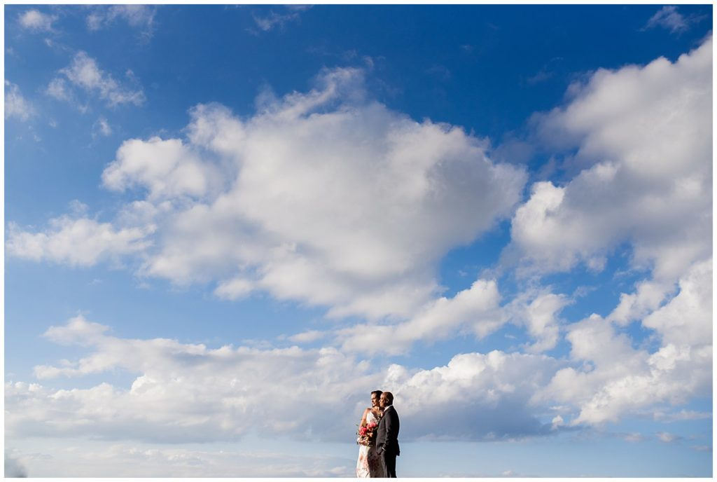 couple in blue sky wedding photo