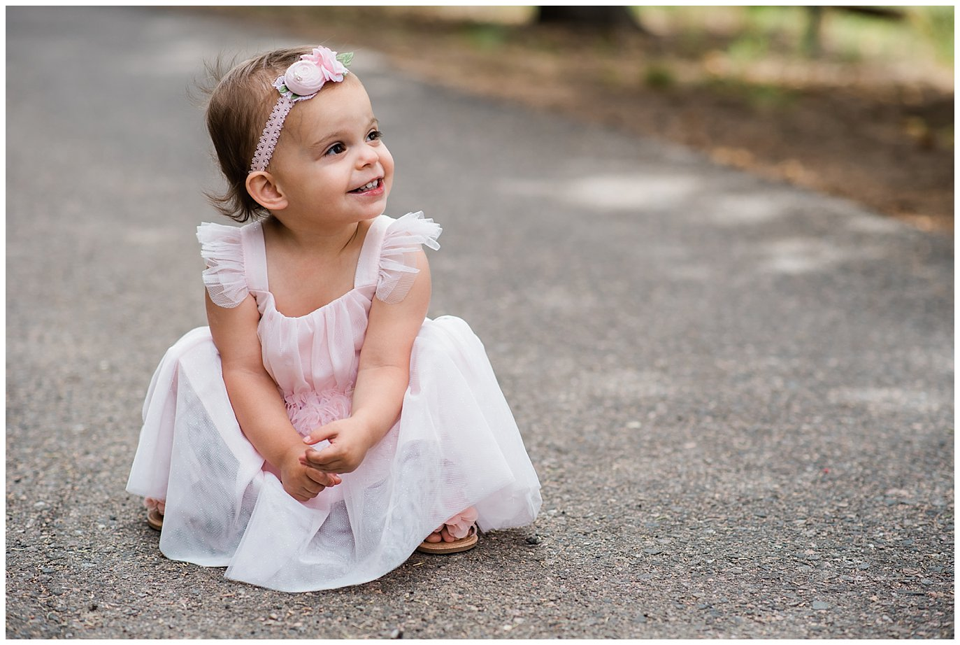 flower girl in pink tulle dress at Deer Creek Valley Ranch wedding by Conifer Wedding Photographer Jennie Crate Photographer