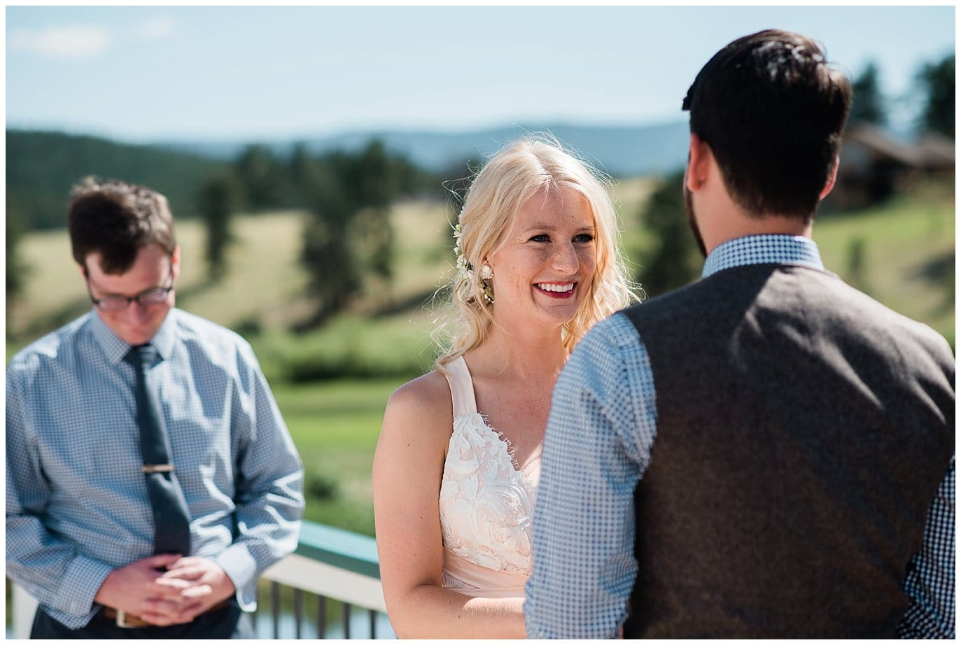 bride and groom say vows on Gazebo at Deer Creek Valley Ranch wedding by Conifer Wedding Photographer Jennie Crate Photographer