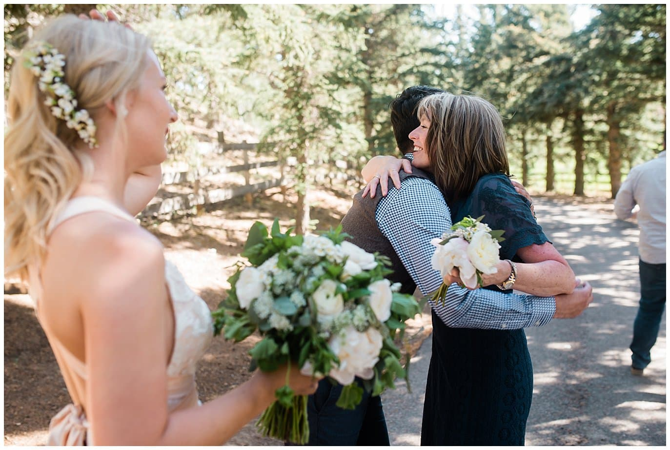 groom hugs mom after ceremony at Deer Creek Valley Ranch wedding by Conifer Wedding Photographer Jennie Crate Photographer