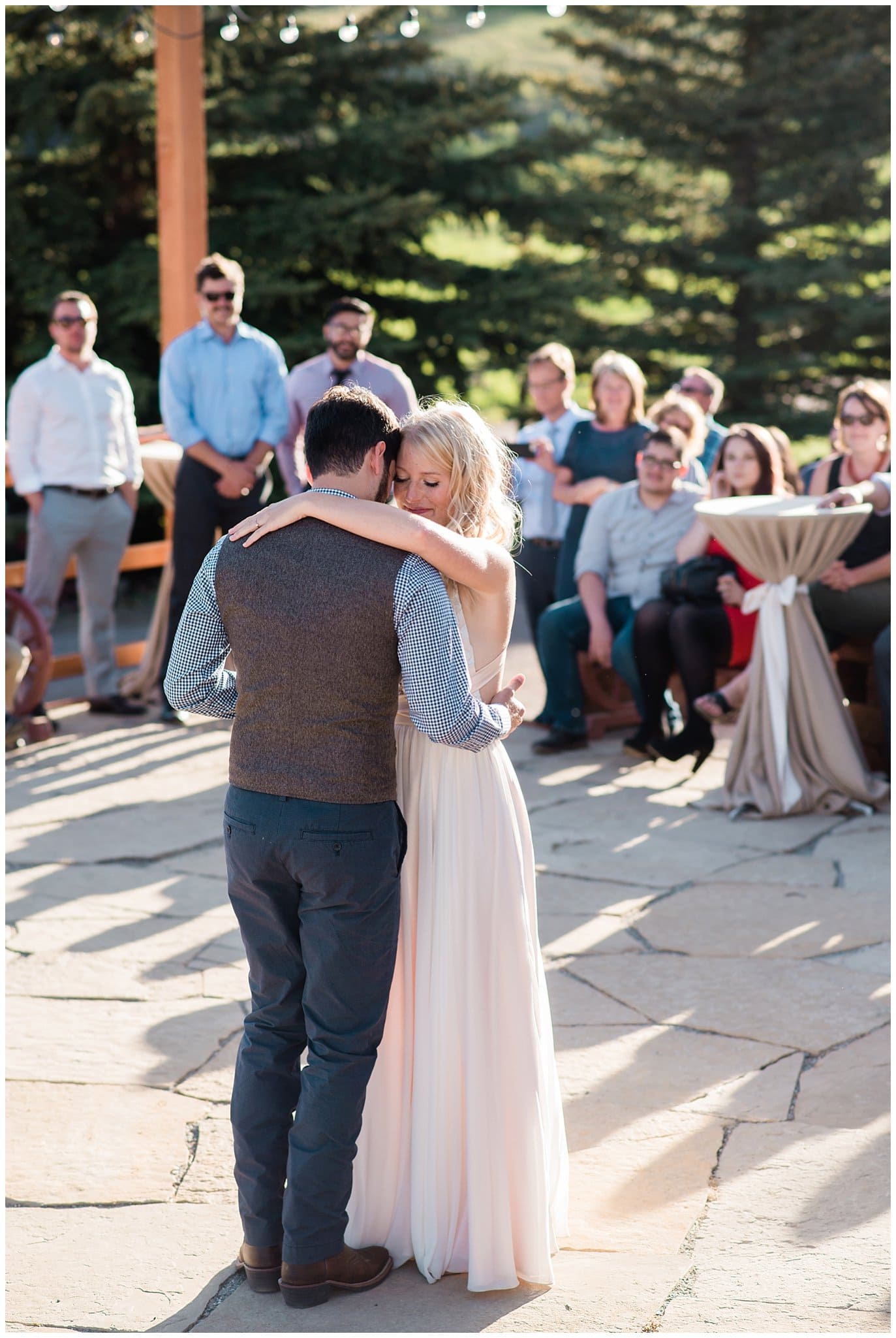Romantic outdoor colorado first dance at Deer Creek Valley Ranch wedding by Boulder Wedding Photographer Jennie Crate Photographer