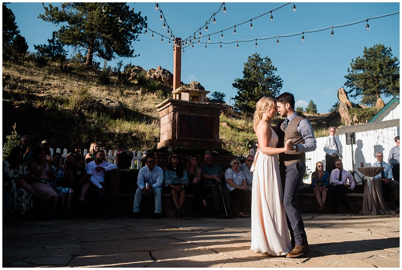 first dance on deer creek valley ranch outdoor patio at Deer Creek Valley Ranch wedding by Boulder Wedding Photographer Jennie Crate Photographer