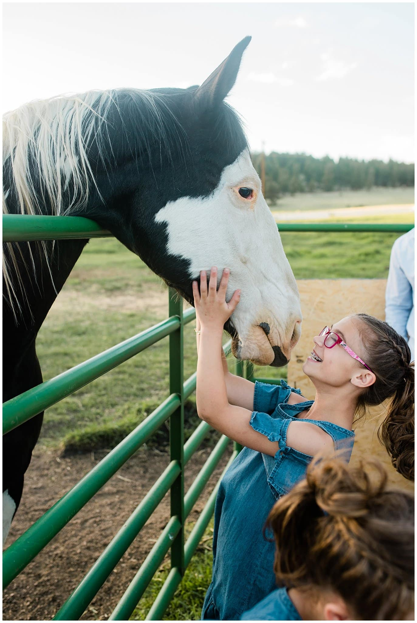Flower Girl with Horses at Deer Creek Valley Ranch wedding by Colorado Wedding Photographer Jennie Crate Photographer