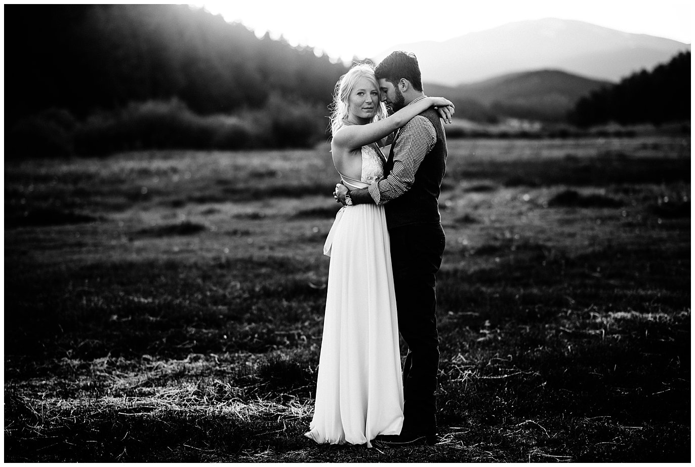 dramatic black and white bride and groom portrait at sunset at Deer Creek Valley Ranch wedding by Colorado Wedding Photographer Jennie Crate Photographer