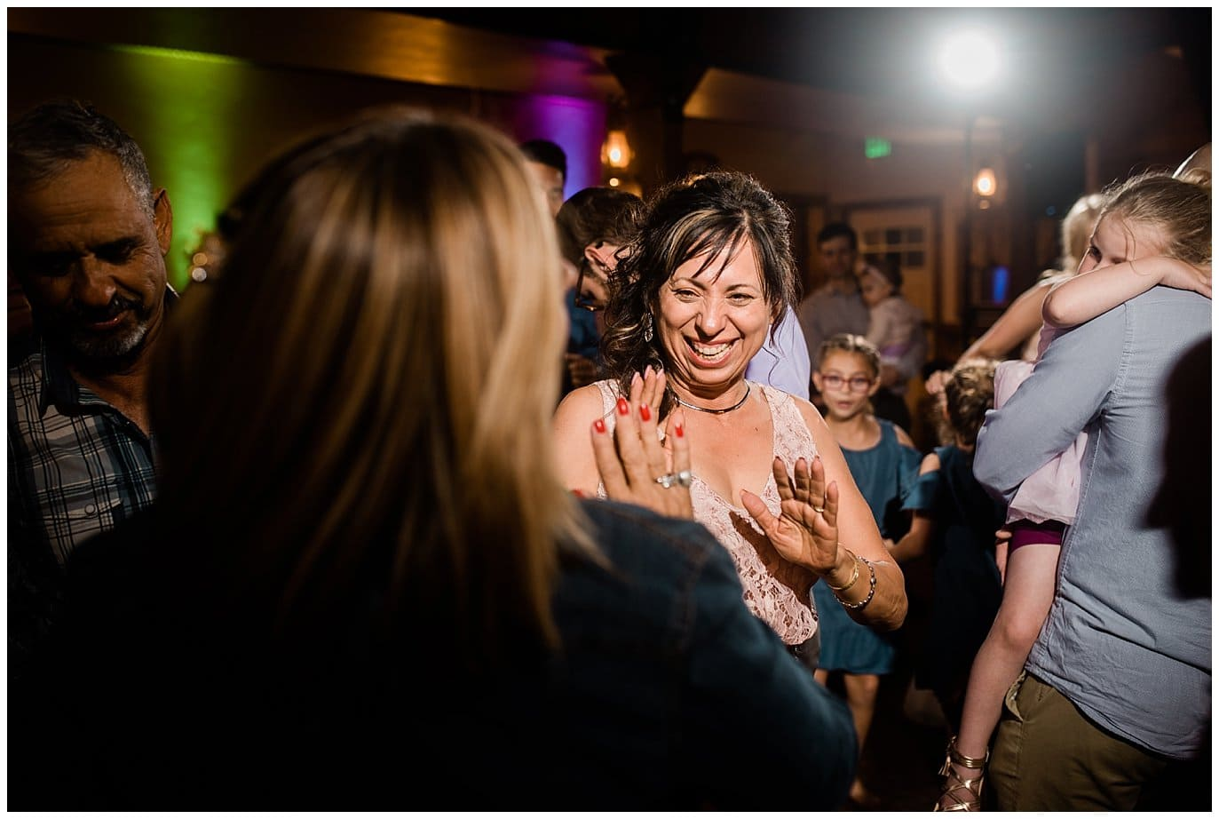 wedding dancing in barn at Deer Creek Valley Ranch wedding by Colorado Wedding Photographer Jennie Crate Photographer