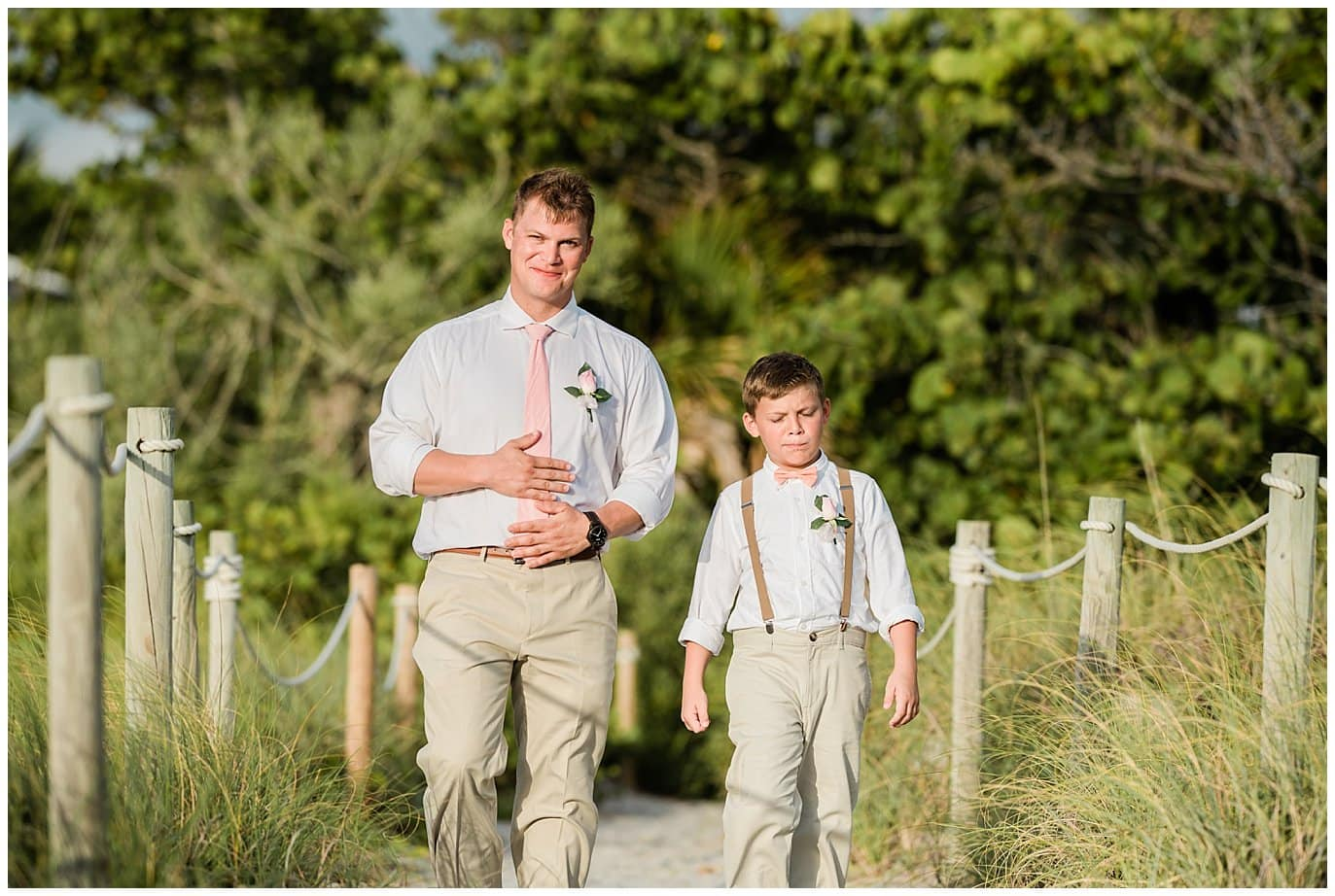Groom and son walking down island beach wedding photo