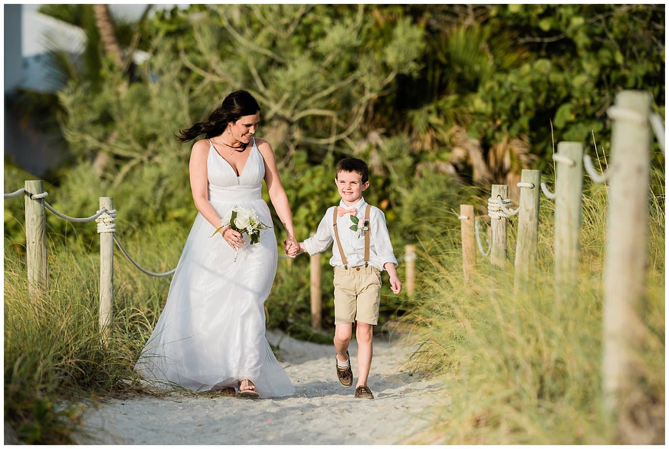 bride and son walk down island beach wedding photo