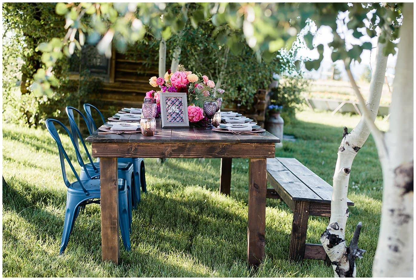 rusic farm table with colorful flowers photo