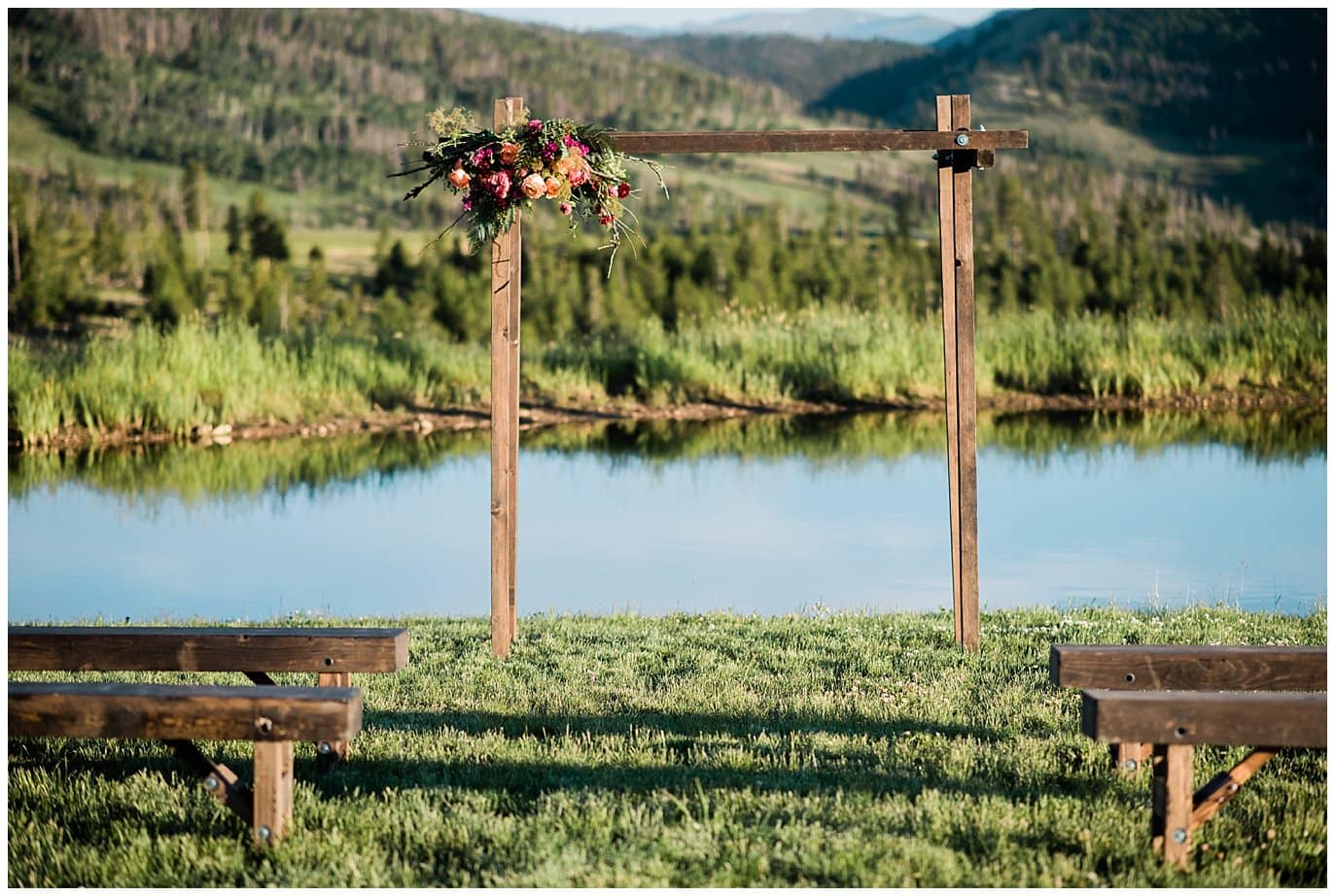 Wooden arch and wooden ceremony bench photo