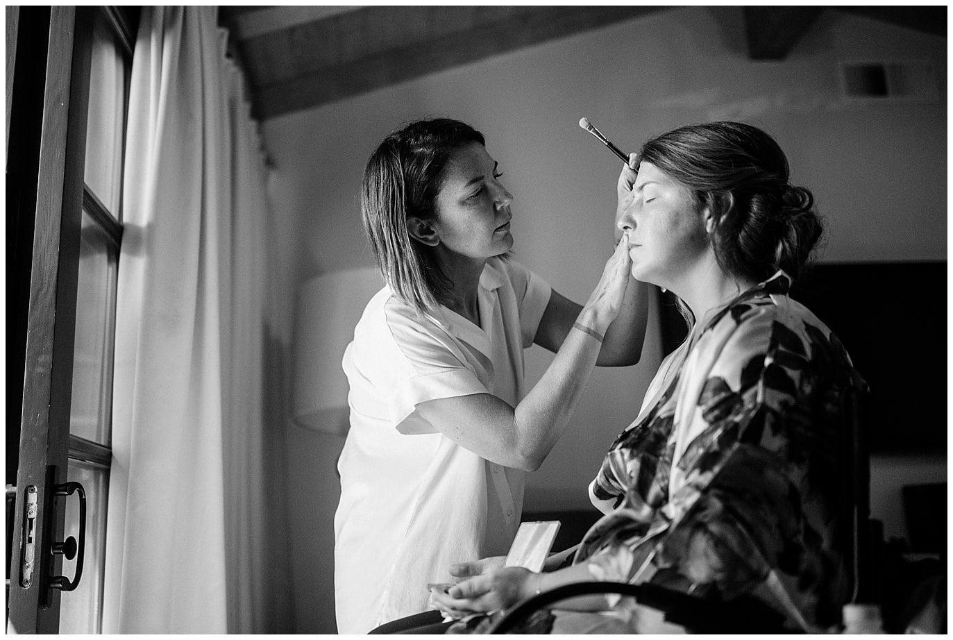 Bride getting make up done in Rancho Valencia villa photo