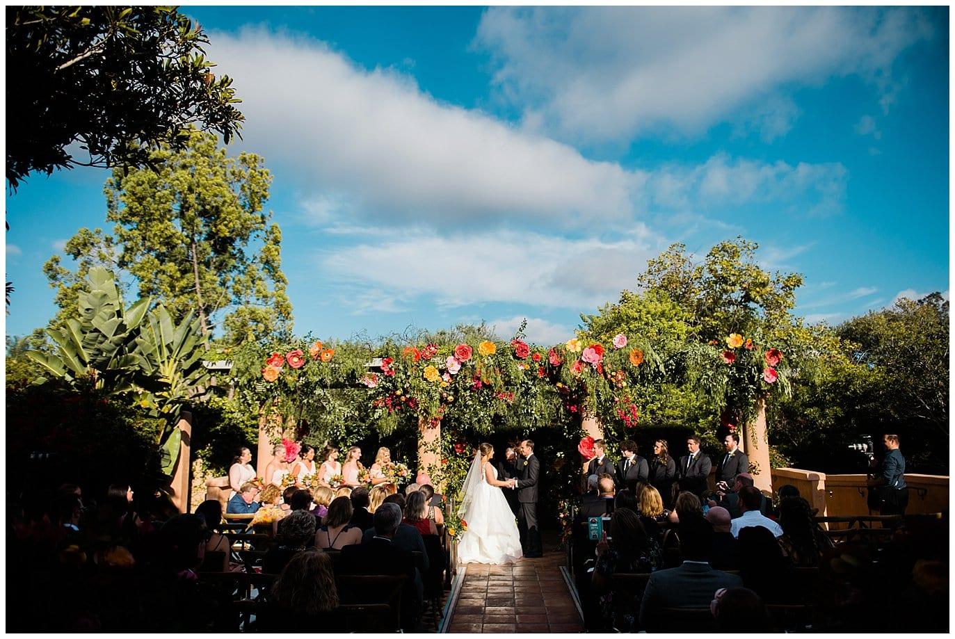 colorful Rancho Valencia wedding ceremony photo
